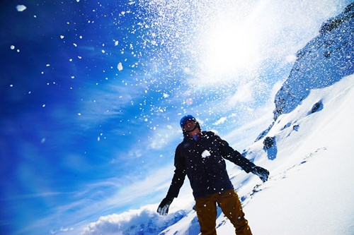 Morzine, throwing snow into blue sky.jpg