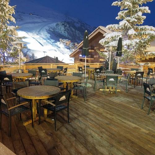 terrace at night at Hotel Le Mottaret, ski hotel in Meribel ski resort