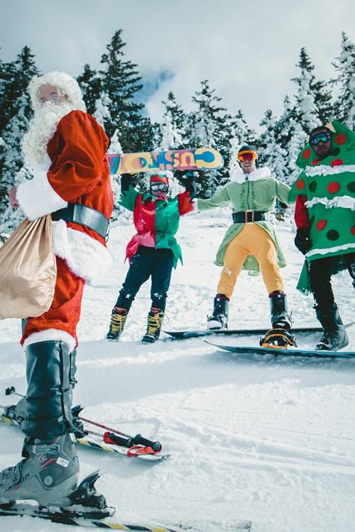 Skiing at Christmas, Santa and elves are skiing/snowboarding. Ski Christmas
