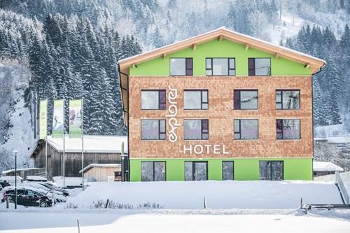 Explorer Hotel, Ski Hotel in St Johann, Austria, exterior in snow