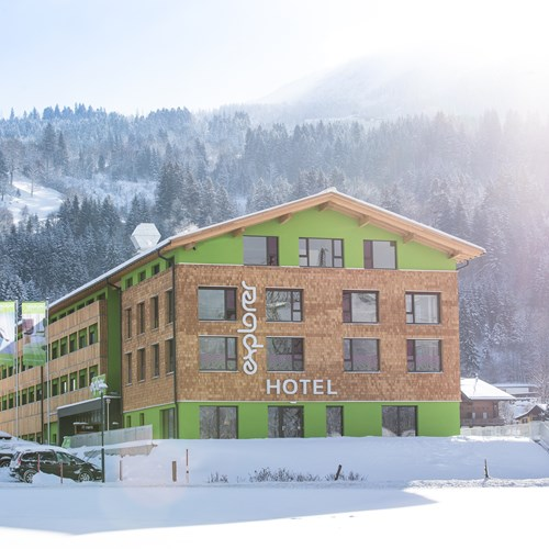 Snowy exterior of ski accommodation, Explorer Hotel in St Johann, Austria