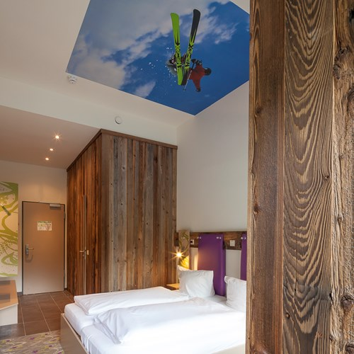 Twin room at Explorer Hotel, ski accommodation in St Johann, Austria
