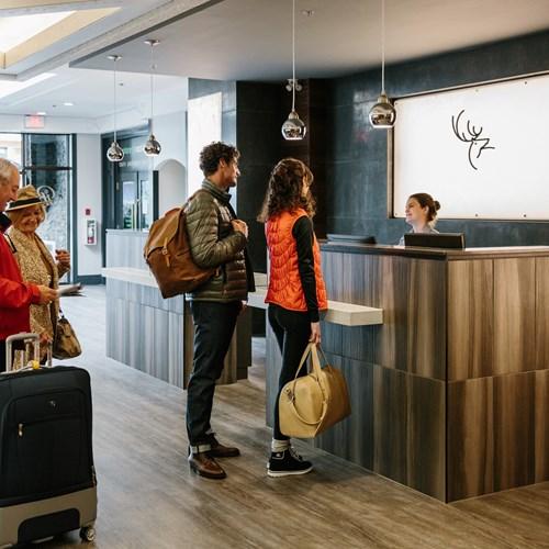 Elk + Avenue Hotel, contemporary ski hotel in Banff - check in at reception