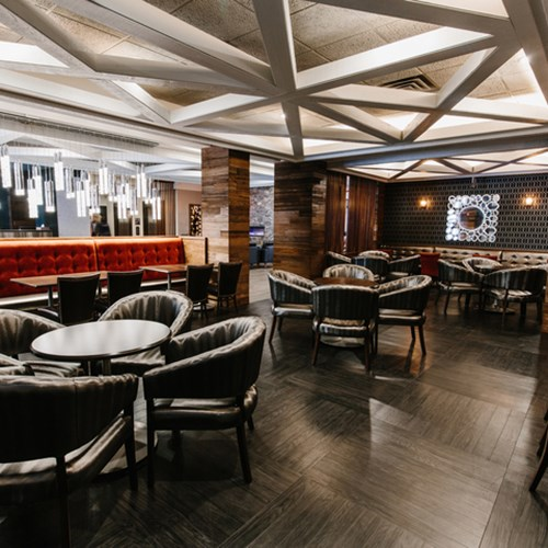 Elk + Avenue Hotel, contemporary ski hotel in Banff - bar and seating area