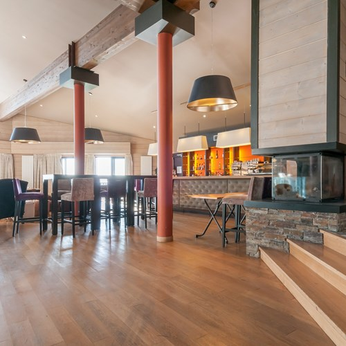 Residence L'Amara Avoriaz France bar area seating and large fire