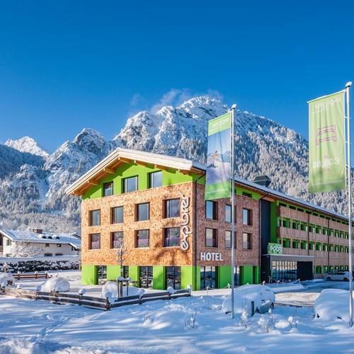 Snowy exterior of ski accommodation, Explorer Hotel in St Johann, Austria