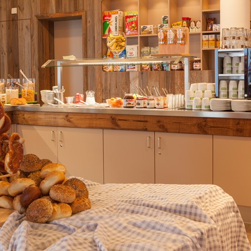 Breakfast room and buffet at Explorer Hotel, ski accommodation in St Johann