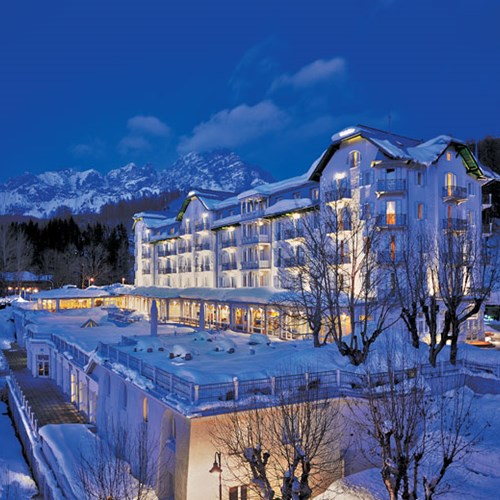 snowy exterior of the Hotel Cristallo in Cortina, Italy