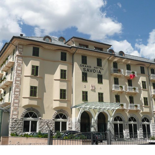 Grand Hotel Savoia Cortina exterior in blue skies
