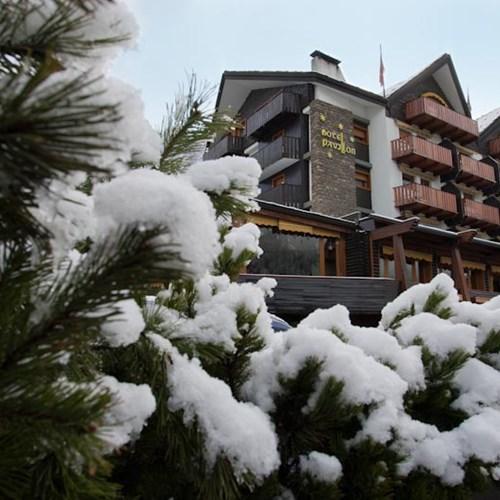 snowy exterior of Hotel Pavillon Courmayeur