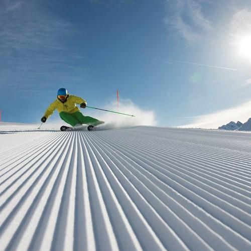 st anton fresh tracks piste basher skier