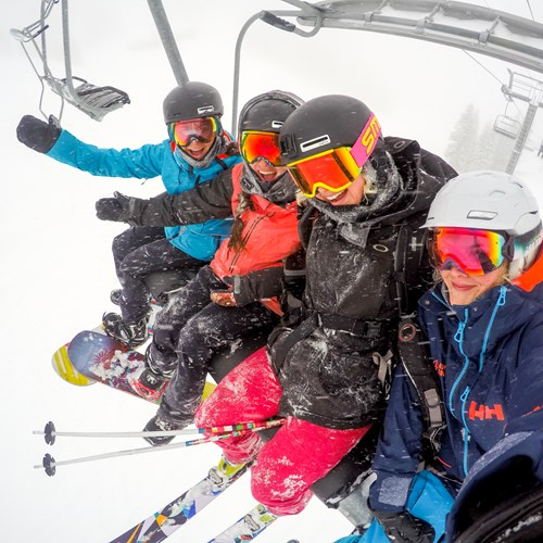 chairlift snowing mates