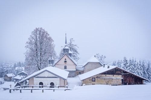 snowy church megeve