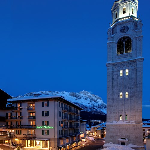 beside the clocktower Hotel Cortina ski accommodation