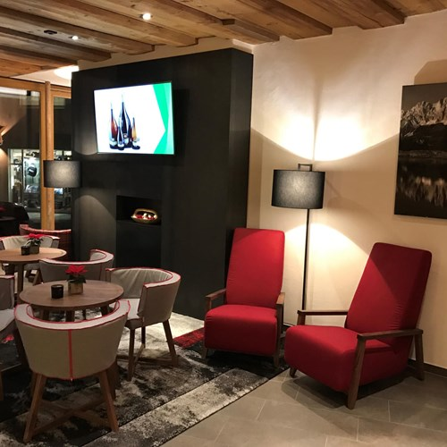 Fire in lounge at Hotel Fischer, ski accommodation in St Johann, Austria