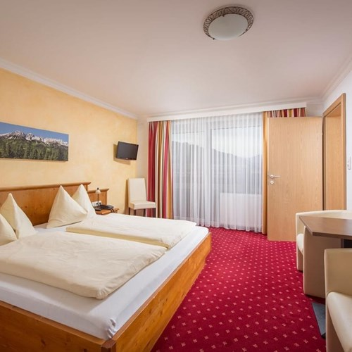 Double room at Hotel Fischer, ski accommodation in St Johann, Austria