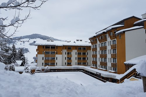 Royal Rochebrune Hotel, Ski Accommodation in Megeve, France - exterior in snow