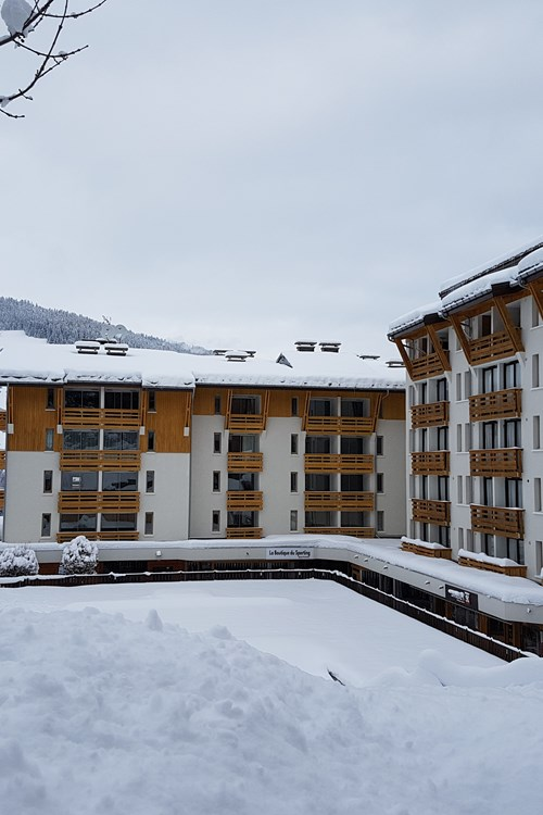 snowy exterior of hotel Royal Rochebrune Megeve, France