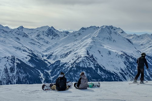 St Anton - Skiing - two boarders sat.jpg