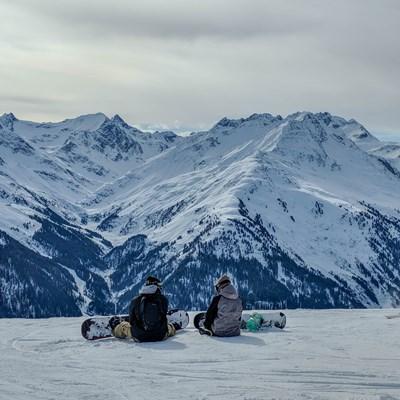 St Anton - Skiing - two boarders sat.jpg