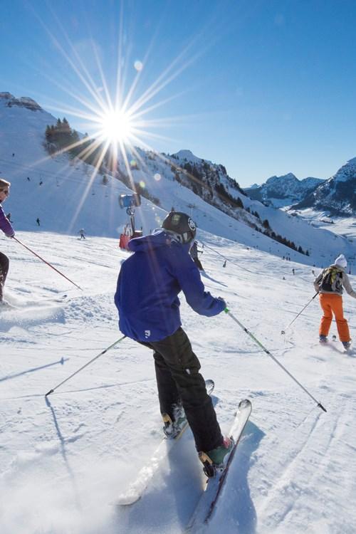 La Clusaz - 3 skiers in the sun.jpg