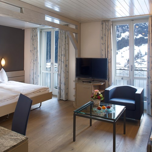 Hotel Belvedere-ski accommodation in Grindelwald-eiger room with sofa bed