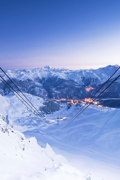 Courchevel ski weekends lift cables view of town sunset