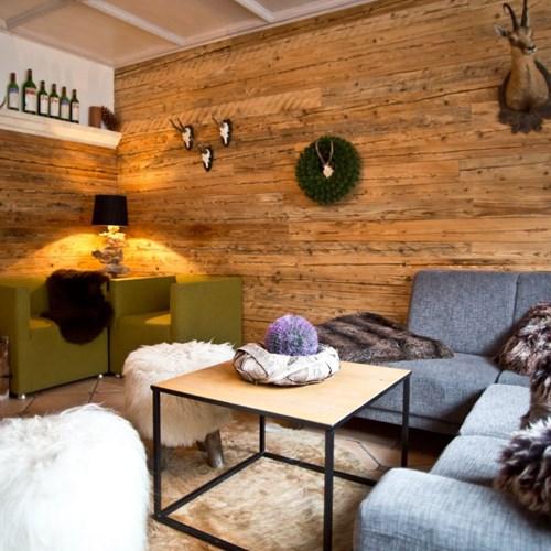 Hotel Gamshof-kitzbuhel ski accommodation-lounge with fur throws