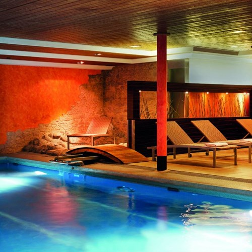 Indoor swimming pool at H+ Hotel and spa in Engelberg