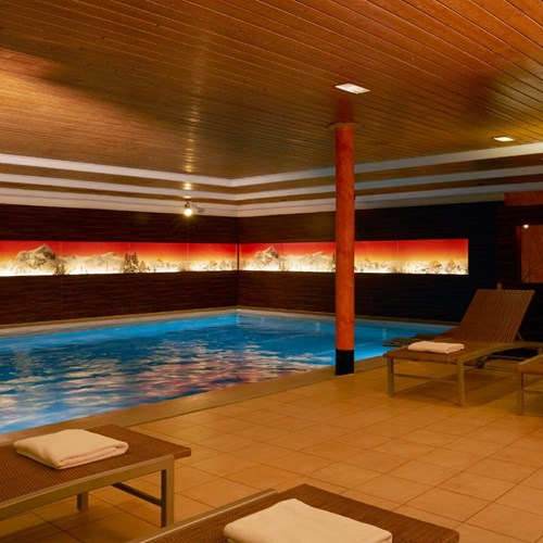 Indoor swimming pool at the H+ Hotel and spa in Engelberg